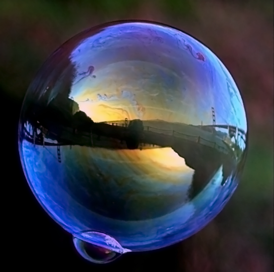 A smaller bubble merging with a super bubble