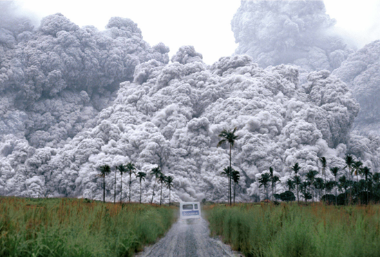 Volcanic ash pouring across land in the Phillipines
