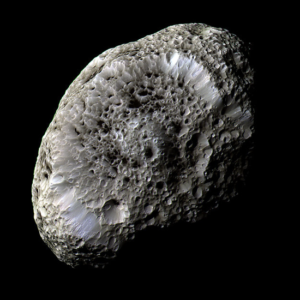 Taken on 26 September 2005 by the NASA/ESA/ASI Cassini spacecraft, reveals crisp details and variations in colour across the strange surface of Saturn's Hyperion moon
