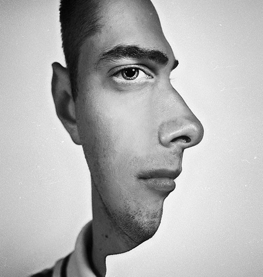 Optical illusion - two profiles of a man's face in one