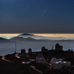 Inversion layer on the outskirts of the Atacma Desert shows a Geminids meteor falling in a perfectly dark sky above the apparently daylight landscape surrounding the La Silla Observatory