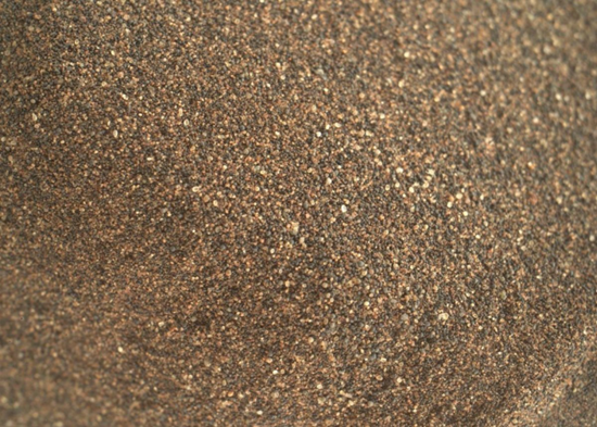 Closeup photo of some of the larger grains of sand that Curiosity rover dug out of the Namib Dune