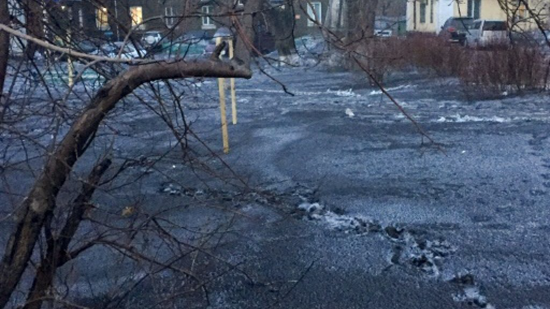 Black snow on the ground in Russia