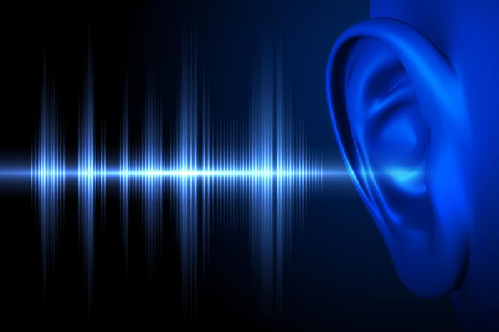 Sound waves entering an ear