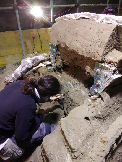 Roman chariot found near the ancient Roman city of Pompeii archaeologist working